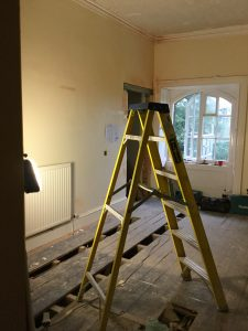 an image of a bedrooms at the Coul House Hotel undergoing refurbishment, image show bare floor boards and ladders.