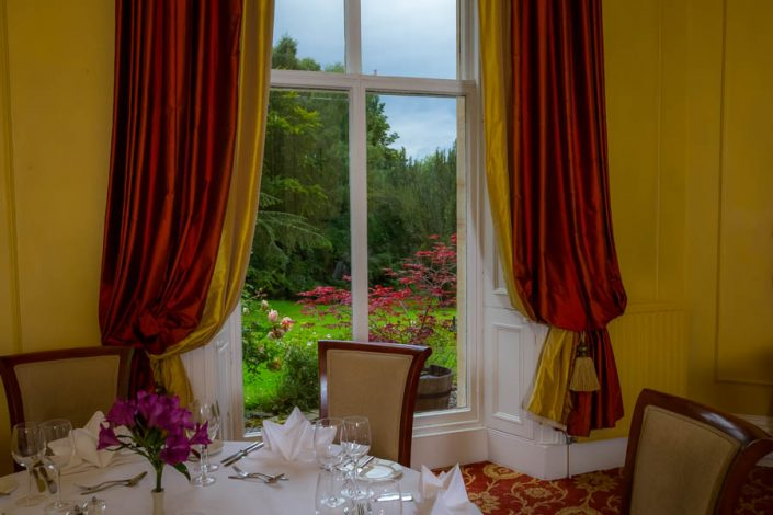 A table with a stunning view of the Gardens at the Coul House Hotel, Contin, Scotland.