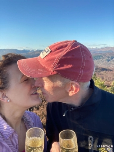 Coul House Celebrations in the Scottish Highlands. Stuart and Susannah MacPherson celebrating their wedding anniversary at the top of Tor Achhilty, Contin.